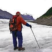 Lone hiker on the Root Glacier in giant Wrangell-St. Elias National Park Alaska.