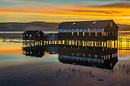 Sunrise over boat launch building on Tomales Bay at Inverness, near Point Reyes, Marin County, California