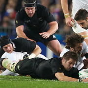 Richie McCaw, New Zealand, playing in his 100th test match, shows courage as he dives for a loose ball during the New Zealand V France, Pool A match during the IRB Rugby World Cup tournament. Eden Park, Auckland, New Zealand, 24th September 2011. Photo Tim Clayton...