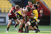 Crusaders Scott Barrett is wrapped up in a tackle in the Super Rugby match, Hurricanes v Crusaders, Sky Stadium, Wellington, Sunday, April 11, 2021. Copyright photo: Kerry Marshall / www.photosport.nz