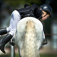 SERIE ROOKIE <br /> Nederland, Reuver, 01-08-2015.<br /> Kampioneschappen Dressuur Regio Limburg, Pony's, Categorie A/B <br /> Foto : Klaas Jan van der Weij
