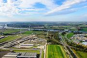 Nederland, Zeeland, Zeeuws-Vlaanderen, 19-10-2014; Sluiskil, Kanaal Gent-Terneuzen, kanaalkruising Sluiskil. Bouwpunt van de tunnel. De brug in de N61 sluit zeer regelmatig voor zeeschepen en dit veroorzaakt files. Daarom zal de kanaalbrug vervangen worden door een tunnel, de Sluiskiltunnel (oplevering 2015).<br /> The pivot bridge over the canal Gent-Terneuzen (Zeeland) closes very regularly for seagoing vessels and this causes traffic jams. Therefore, the canal bridge will be replaced by a tunnel, the tunnel Sluiskil (completion 2015).<br /> luchtfoto (toeslag op standard tarieven);<br /> aerial photo (additional fee required);<br /> copyright foto/photo Siebe Swart