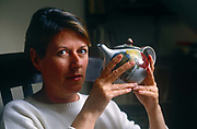 A portrait of ceramicist Janice Tchalenko at home in April 1987 at her home in south London, UK. Janice Tchalenko 1942- was born in Rugby, Warwickshire. She is a ceramic artist best known for her success in translating decorative studio pottery into designs for batch and large-scale production.