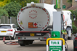 © Licensed to London News Pictures 28/09/2021.<br /> Mottingham, UK, A tanker has just delivered fuel to Mottingham BP station in South East London. Within minutes of the tanker arriving motorists started to queue blocking roads. Chaos at the forecourts as people start to panic buy petrol. BP has started to ration petrol and diesel due to a shortage of truckers. Photo credit:Grant Falvey/LNP