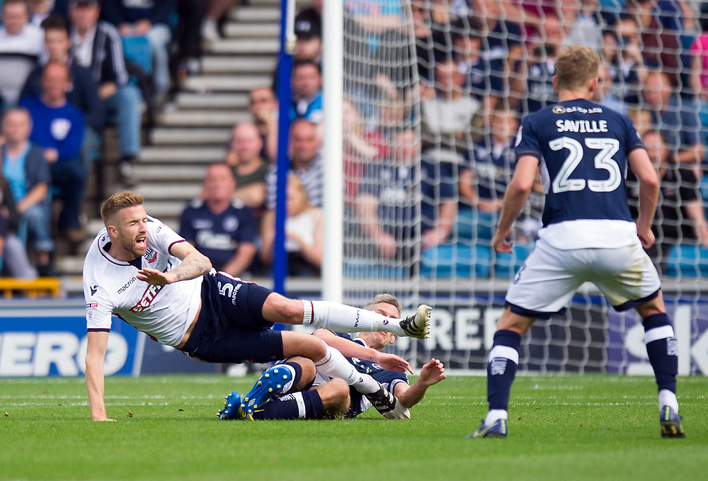 Bolton Wanderers' Mark Beevers is fouled by Millwall's Steve Morison<br /> <br /> Photographer Ashley Western/CameraSport<br /> <br /> The EFL Sky Bet Championship - Millwall v Bolton Wanderers - Saturday August 12th 2017 - The Den - London<br /> <br /> World Copyright © 2017 CameraSport. All rights reserved. 43 Linden Ave. Countesthorpe. Leicester. England. LE8 5PG - Tel: +44 (0) 116 277 4147 - admin@camerasport.com - www.camerasport.com