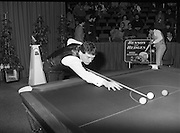 """The Benson and Hedges .Irish Masters Snooker..1984..28.03.1984..03.28.1984..28th March 1984..The championship was held at Goffs,Co Kildare. All the top names in snooker took part..Steve Davis,Jimmy White,Eddie Charlton,.Tony Knowles,Dennis Taylor,Tony Meo,.Alex Higgins,Ray Reardon,.Cliff Thorburn,Terry Griffiths,.Bill Werbeniuk and Eugene Hughes..The eventual winner was Steve Davis who beat Terry Griffiths 9 -1 in the final..Image as Jimmy White """"breaks"""" to get the second frame underway, as Tony Meo gets a drink.."""