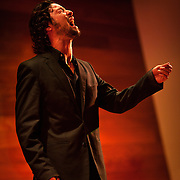 A flamenco singer in performing on stage in Almeria, Spain.