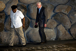 Former US President Jimmy Carter (R) and Bishop Desmond Tutu, both Nobel Peace Prize laureates, look down at the raised letters of the Ravensbrueck and Westerbork Nazi concentration camps as they enter the 'Hall of Remembrances' in the Yad Vashem Holocaust memorial in Jerusalem, Israel on 25 August 2009, during a ceremony honoring the six-million Jews exterminated by the Nazis in World War II. The two are part of the group called 'The Elders' and are on their first visit as a group to Israel and the Palestinian Authority area in the West Bank in order to offer their support for those working hard to promote peaceful coexistence. Photo by Olivier Fitoussi/ABACAPRESS.COM    199634_006 Jerusalem Israël