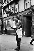 12/02/1963<br /> 02/12/1963<br /> 12 February 1963<br /> Newsboy, John Murphy, outside Aer LIngus office on O'Connell Street, Dublin.
