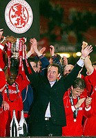 Photo: Scott Heavey.<br /> Middlesbrough v Bolton Wanderers. Carling Cup Final. 29/02/2004.<br /> Steve Gibson the Boro chairman celebrates with his team