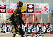 © Licensed to London News Pictures. 30/11/2011, London, UK. A woman walks past stored placards before the march begins. Up to two million public sector workers are staging a strike over pensions in what is set to be the biggest walkout for a generation. Photo credit : Stephen Simpson/LNP