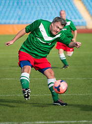 © London News Pictures. 21/09/2013 . Manchester, UK.  British Shadow Chancellor ED BALLS taking part in a football match between Labour Members of Parliament and journalists in Manchester, on the opening day of the 2014 Labour Party Annual Conference, which is being held in Manchester. Photo credit : Ben Cawthra/LNP