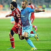 Trabzonspor's Serkan Balci (R) and Besiktas's Olcay Sahan (L) during their Turkish SuperLeague Derby match Trabzonspor between Besiktas at the Avni Aker Stadium at Trabzon Turkey on Saturday, 09 March 2013. Photo by TURKPIX
