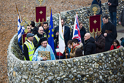 © Licensed to London News Pictures. 08/01/2017. Brighton, UK. Members of the Brighton Orthodox Church take part in the Blessing of the Waters. Priest Germanos Kourkounis leads the congratation to the seafront for a ceremony and blesses the water with Holy cross and water. Photo credit: Hugo Michiels/LNP