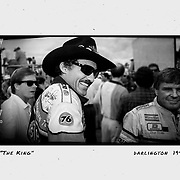 Richard Petty talks to fans as he heads to driver introductions before the Southern 500 in 1992. ©Travis Bell Photography