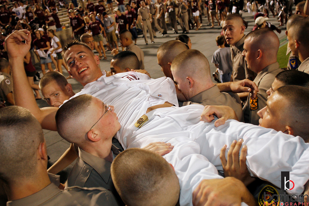 A Texas A&M University yell leader is carried off the field by members of the Corps of Cadets following the Aggies' win over Montana State on Saturday, Sept. 1, 2007. The yell leaders are carried to the campus fish pond following a victory. A&M won the game 38-7.