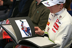 Slovenian cross-country skier Petra Majdic watches an album with her photos at Alpina presentation of new cross-country shoes with red dot award: product design, on April 24, 2008, in Pokljuka, Rudno polje, Slovenia.  (Photo by Vid Ponikvar / Sportal Images)/ Sportida)
