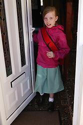 Girl in school uniform going to school,
