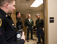 Officer Callahan and Lieutenant James Leach gives a tour of the Safe Room with Don Bilodeau and Allan Whitney during Thursday evenings Open House.  (Karen Bobotas/for the Laconia Daily Sun)