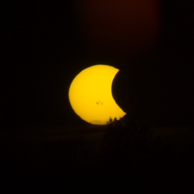 I left my ND filters at home by accident. Luckily there was a guy with a piece of glass from a welder's mask so we helped each other out. http://Duncan.co/partial-solar-eclipse-photos/