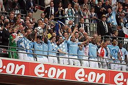 14.05.2011, Wemblay Stadium, ENG, FA CUP FINALE, Manchester City vs Stoke City im Bild Manchester City's Carlos Tevez  and  Manchester City's team lift the FA Cup during   the 130th  FA Cup Final  between Manchester City and Stoke City at Wembley Stadium in London    on 14/05/2011, EXPA Pictures © 2011, PhotoCredit: EXPA/ IPS/ M. Pozzetti *** ATTENTION *** UK AND FRANCE OUT!