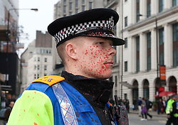 "© under license to London News Pictures. 25/03/2011: A policeman is splattered with paint on Tottenham Court Road in London, during anti-cuts protests. Credit should read ""Joel Goodman/London News Pictures""."