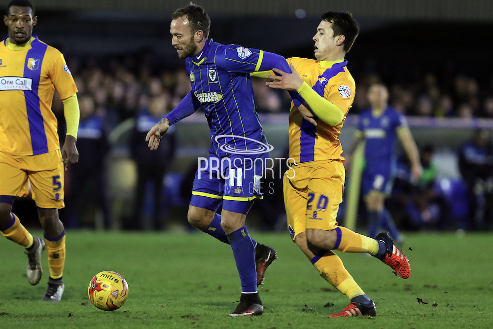 Sean Rigg of AFC Wimbledon in action  during the Sky Bet League 2 match between AFC Wimbledon and Mansfield Town at the Cherry Red Records Stadium, Kingston, England on 16 January 2016. Photo by Stuart Butcher.