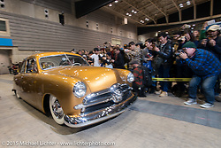 Ashley Cunningham in his 1950 Ford Custom Shoebox for the Grand Entry into the Mooneyes Yokohama Hot Rod & Custom Show. Yokohama, Japan. December 6, 2015.  Photography ©2015 Michael Lichter.