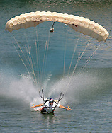 Charles Bryan, member of the Red Bull Air Force, makes a water landing on Town Lake during the Red Bull Fl?gtag on April 26, 2003 in Austin, TX.