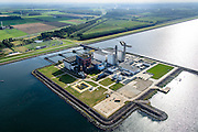 Nederland, Flevoland, Gemeente Lelystad, 10-10-2014. Maximacentrale (voorheen Flevocentrale) van Electrabel, op een eigen kunstmatig aangelegd eiland in het IJsselmeer. Twee nieuwe stoom- en gaseenheden (STEG) met aardgas als brandstof, relatief schoon en met hoog-rendement (STEG-eenheden).<br /> Maxima power plant (formerly Flevocentrale) of Electrabel, on its own artificial island in the IJsselmeer. Two new steam and gas units (CCGT) with natural gas as fuel, relatively clean and high-efficiency (combined cycle units). <br /> luchtfoto (toeslag op standard tarieven);<br /> aerial photo (additional fee required);<br /> copyright foto/photo Siebe Swart