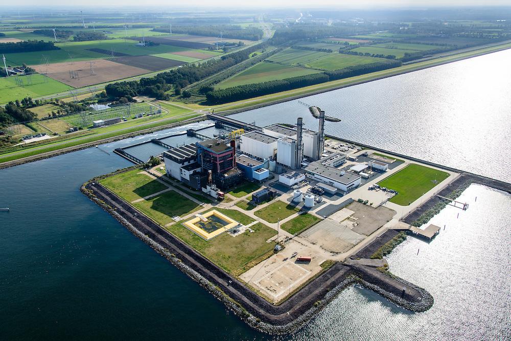 Nederland, Flevoland, Gemeente Lelystad, 10-10-2014. Maximacentrale (voorheen Flevocentrale) van Electrabel, op een eigen kunstmatig aangelegd eiland in het IJsselmeer. Twee nieuwe stoom- en gaseenheden (STEG) met aardgas als brandstof, relatief schoon en met hoog-rendement (STEG-eenheden).<br /> Maxima power plant (formerly Flevocentrale) of Electrabel, on its own artificial island in the IJsselmeer. Two new steam and gas units (CCGT) with natural gas as fuel, relatively clean and high-efficiency (combined cycle units). <br /> luchtfoto (toeslag op standard tarieven);<br /> aerial photo (additional fee required);<br /> copyright foto/photo Siebe Swart