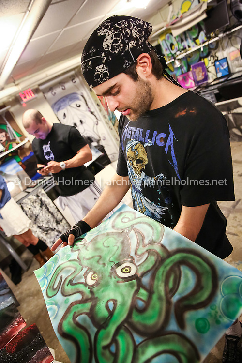 (6/25/14, FRAMINGHAM, MA) Artist Graham Lage, of Framingham, talks about one of his pieces of art at the Tempo Young Adult Resource Center in Framingham on Wednesday. Daily News and Wicked Local Photo/Dan Holmes