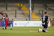 Scunthorpe United Emannuel Onariase (6) takes the knee during the EFL Sky Bet League 2 match between Scunthorpe United and Grimsby Town FC at the Sands Venue Stadium, Scunthorpe, England on 23 January 2021.