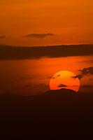 The sun setting over Amboseli National Park, Kenya