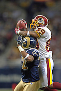 Washington Redskins wide receiver Santana Moss (R) makes a first down catch over St. Louis Rams defensive back Ron Bartell (L) in the third quarter, during the Redskins 24-9 win at the Edward Jones Dome in St. Louis, Missouri, December 4, 2005.