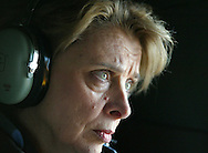 Gov Christine Gregoire watches out the window of a Washington National Guard helicopter while viewing flooded areas over southwest, Washington. (AP Photo/John Froschauer)