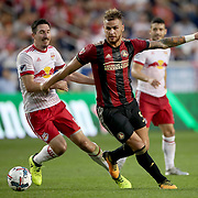 HARRISON, NEW JERSEY- OCTOBER 15: Leandro Gonzalez #5 of Atlanta United challenged by Sacha Kljestan #16 of New York Red Bulls during the New York Red Bulls Vs Atlanta United FC, MLS regular season match at Red Bull Arena, Harrison, New Jersey on October 15, 2017 in Harrison, New Jersey. (Photo by Tim Clayton/Corbis via Getty Images)