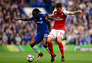 Granit Xhaka of Arsenal battles with Victor Moses of Chelsea (l). Premier league match, Chelsea v Arsenal at Stamford Bridge in London on Sunday 17th September 2017.<br /> pic by Andrew Orchard sports photography.