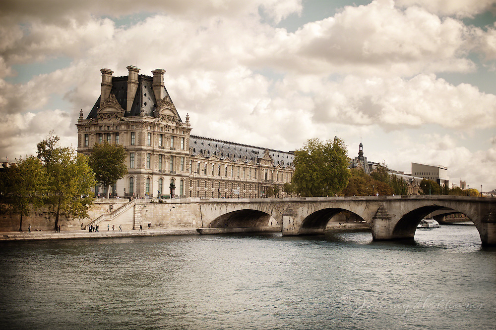 The famous Louvre sits on the edge of La Seine in Paris, France