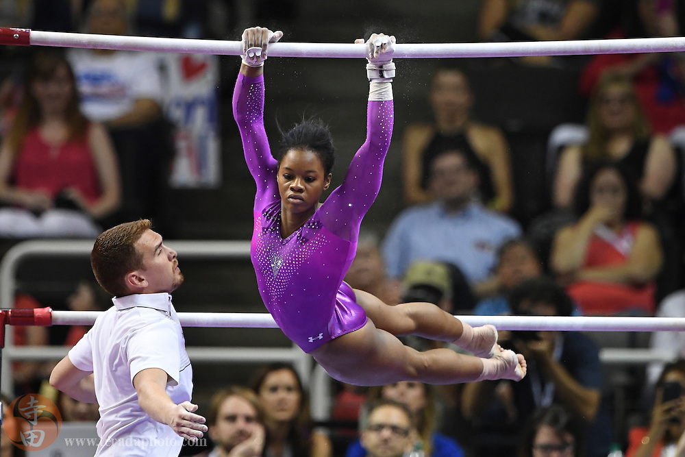 July 8, 2016; San Jose, CA, USA; Gabby Douglas, from Tarzana, CA, during the uneven bars in the women's gymnastics U.S. Olympic team trials at SAP Center.