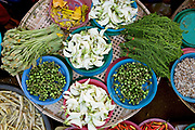 Pea aubergines, pumpkin flowers, dok kare flowers and ferns for sale at Hua Kua evening market on the outskirts of Vientiane, Lao PDR. A large variety of local products are available for sale in fresh markets all over Laos, all being sold on small individual stalls