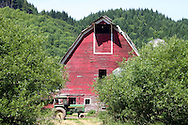 Old red barn with ubiquitous John Deere tractor.