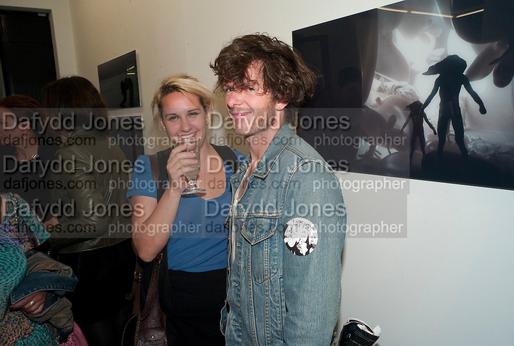 """DICKIE GRAHAM; KATIE GLASS; , Video artist Yi Zhou  first solo show """"I am your Simulacrum"""".Exhibition opening at 20 Hoxton Square Projects. Hoxton Sq. London. 1 September 2010.  -DO NOT ARCHIVE-© Copyright Photograph by Dafydd Jones. 248 Clapham Rd. London SW9 0PZ. Tel 0207 820 0771. www.dafjones.com."""