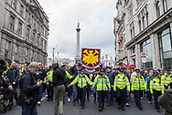 Police lead FLA supporters from Trafalgar Square during the Football Lads Alliance march between Park Lane and Westminster Bridge, London on 7 October 2017. Photo by Phil Duncan.