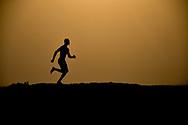 Barefoot black man running