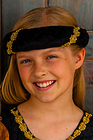 Preteen girl dressed in medieval costume, Cedar City, Utah USA. Cedar City is home to the Tony Award-winning Utah Shakespeare Festival.