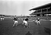 24/02/1963<br /> 02/24/1963<br /> 24 February 1963<br /> Railway Cup Semi-Final: Leinster v Connacht at Croke Park, Dublin. <br /> P. Burke (Connacht) seems to be wrestling with E. Wheeler (Leinster) hidden in this tussle near the Connacht goal.