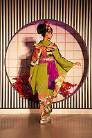 Kimono Fashion Show at Nishijin Textiles; Kimono are made of silk and normally very expensive though there is now a thriving market in second hand kimono. Nowadays they are worn at formal or traditional occasions such as funerals, weddings or tea ceremonies. Kimono differ in style and color depending on the occasion on which it is worn and the age and marital status of the person wearing it. To put on a kimono needs some practice. Especially tying the belt (obi) alone is difficult so that many people require assistance. Wearing a kimono properly includes proper hair style, traditional shoes, socks, underwear, and a small handbag for women.