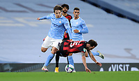 Football - 2020 / 2021 EFL Carabao Cup - Round Three - Manchester City vs AFC Bournemouth<br /> <br /> Adrian Bernabe of Manchester City and Adam Smith of Bournemouth at the Etihad Stadium.<br /> <br /> <br /> COLORSPORT/LYNNE CAMERON