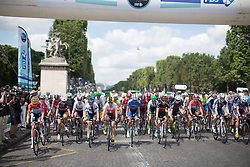 The riders start the La Course, a 89 km road race in Paris on July 24, 2016 in France.